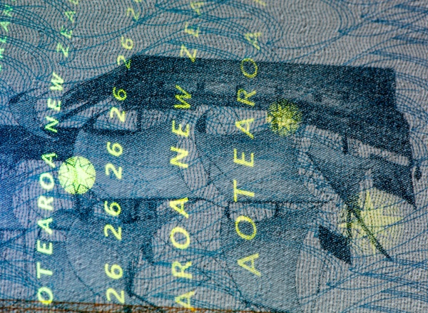 Close up of New Zealand passport page with old ship and infrared highlighted text